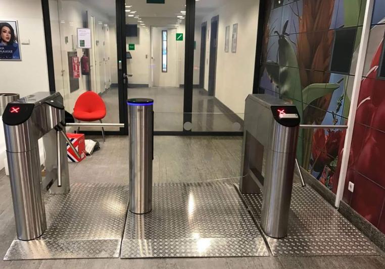 temporary turnstiles in office building